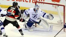 Ottawa Senators' Kyle Turris scores past Tampa Bay Lighting goaltender Anders Lindback (FRED CHARTRAND/THE CANADIAN PRESS)