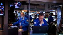 Traders work on the floor of the New York Stock Exchange (NYSE) on Monday, Nov. 28. (Michael Nagle/Bloomberg)