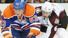 Colorado Avalanche's Bryan Allen, right, trips the Edmonton Oilers' Ales Hemsky during first period NHL hockey action in Edmonton on Friday, December 9, 2011. THE CANADIAN PRESS/John Ulan (John Ulan/CP)
