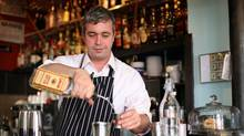 St. John Frizell mixes a drink at the new bar Fort Defiance.