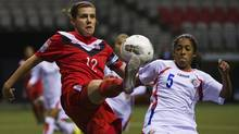 Costa Rica's Diana Saenz and Canada's Christine Sinclair try to control the ball during the first half of their CONCACAF women's Olympic qualifying soccer match in Vancouver. (ANDY CLARK/Reuters)