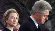 First lady Hillary Rodham Clinton watches President Clinton pause as he thanks those Democratic members of the House of Representatives who voted against impeachment in this Dec. 19, 1998 file photo. (AP Photo/Susan Walsh, File) (Susan Walsh / AP / File Photo/Susan Walsh / AP / File Photo)