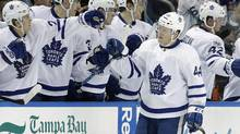 Toronto Maple Leafs defenseman Morgan Rielly celebrates with the bench after scoring against the Tampa Bay Lightning during the second period of an NHL hockey game in Tampa, Fla., on March 16, 2017. (Chris O'Meara/AP)