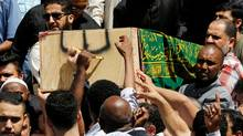 The casket of Abdirahman Abdi, a mentally ill black man who died following his arrest by police, is carried from the Ottawa Mosque after his funeral in Ottawa, Ontario, Canada, July 29 2016. (Chris Wattie/REUTERS)