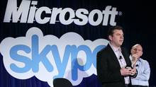 Microsoft CEO Steve Ballmer, right, listens to Skype CEO Tony Bates speaking about the deal in San Francisco on Tuesday. (Justin Sullivan/Getty Images/Justin Sullivan/Getty Images)