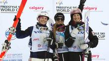 Justine Dufour-Lapointe of Canada, centre, celebrates her first-place finish with her sister Chloe, right, who finished second, and third-place finisher Eliza Outtrim of the U.S. after the Freestyle Ski World Cup Moguls ladies event in Calgary, Alta., on Jan. 26, 2013. (Todd Korol/Reuters)