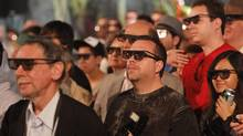 "Guests wear 3-D glasses as they watch a taped briefing from creator Peter Jackson during the opening event for the attraction ""King Kong 360 3-D"" at Universal Studios Hollywood in Universal City, California June 29, 2010 (MARIO ANZUONI)"