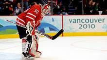 Canada's Martin Brodeur hangs his head after allowing the fourth U.S. goal at Canada Hockey Place in Vancouver , Sunday. (Scott Gardner/THE CANADIAN PRESS)