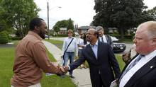 PC candidate Ken Kirupa, centre, campaigned with Toronto Mayor Rob Ford. (Fernando Morales/The Globe and Mail)