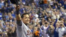 This Oct. 3, 2012 file photo shows Detroit Tigers' Miguel Cabrera waving to the crowd after being replaced during the fourth inning of a baseball game against the Kansas City Royals at Kauffman Stadium in Kansas City, Mo. (Orlin Wagner/AP)