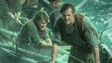 Chris Hemsworth, right, plays First Mate Owen Chase in In the Heart of the Sea, directed by Ron Howard. (Jonathan Prime/AP)
