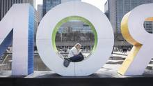 Renae Wooten, who was visiting from Whistler, B.C., enjoys a spring-like day in Toronto on Thursday. (Fred Lum/The Globe and Mail)
