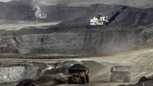Alberta's oil sands don't appear until fifth spot in a Greenpeace study on greenhouse gas emitters, which it shares with projects in Iraq and the United States. (JEFF MCINTOSH/AP)