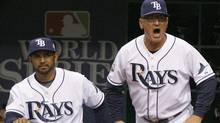 Tampa Bay Rays manager Joe Maddon (R) yells at umpire Tim Welke (not shown) as bench coach Dave Martinez (L) looks on after Rays baserunner Carlos Pena was caught stealing in the sixth inning in Game 1 of Major League Baseball's World Series in St. Petersburg, Florida, October 22, 2008. REUTERS/Hans Deryk (HANS DERYK)