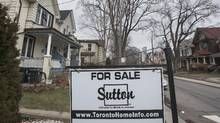 A realtor's sign is placed on the front yard of a home for sale at 138 Barton Ave. in Toronto on Mar 20, 2017. The number of homes for resale in some parts of Toronto are very slim, with housing prices often going for well over asking in some cases. (Fred Lum/The Globe and Mail)