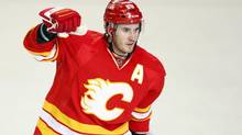 Calgary Flames' Curtis Glencross celebrates his game-winning goal during third period NHL hockey action against the Phoenix Coyotes in Calgary, Alta., Sunday, Feb. 24, 2013. The Calgary Flames beat the Phoenix Coyotes 5-4. (Jeff McIntosh/THE CANADIAN PRESS)