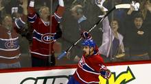 Montreal Canadiens' Tomas Plekanec celebrates his empty-net goal against the Washington Capitals during the final minutes of the third period of Game 6 NHL Eastern Conference quarter-finals hockey action Monday, April 26, 2010 in Montreal. (Paul Chiasson/THE CANADIAN PRESS)