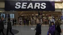 Passersby walk in front of the Sears store at Toronto's Eaton Centre on Oct. 29, 2013. The retailer has been looking for a new financial services partner for its credit card operations since last year. (Fernando Morales/The Globe and Mail)