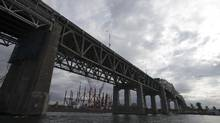 Ottawa has to keep existing Champlain Bridge from collapsing until construction on its replacement, which is being built right beside the old one, is complete. (Christinne Muschi For The Globe and Mail)