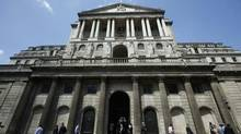 Pedestrians walk past the Bank of England in the City of London. (Luke MacGregor/Reuters)