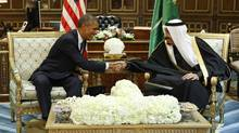 U.S. President Barack Obama (L) shakes hands with Saudi Arabia's King Salman at the start of a bilateral meeting at Erga Palace in Riyadh, in this January 27, 2015 file photo. (JIM BOURG/REUTERS)