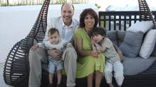 Doug and Trish Queen with their boys: Police call the 'fourth-hand' accusation against him 'completely unfounded.'