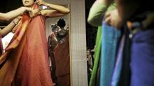 Lakshmi Chand Singh, a 33-year-old architect, learns how to wear a saree. (Mansi Thapliyal)