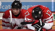 John Quenneville, left, and Travis Konecny react to Canada's quarter-final loss against Finland at the World Junior Championship in Helsinki on Jan. 2. (Sean Kilpatrick/THE CANADIAN PRESS)