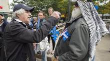 Two men argue during a demonstration in Montreal on Sept. 22, 2013, in support of a proposed Quebec values charter. (Graham Hughes/THE CANADIAN PRESS)