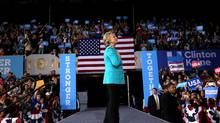 Democratic presidential candidate Hillary Clinton applauds after speaking at a rally at the ClevelandPublic Auditorium in Cleveland, Sunday, Nov. 6, 2016 (Andrew Harnik/AP Photo)