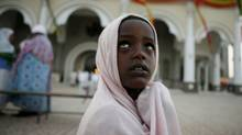 A child arrives to the church for the traditional Orthodox mass for the New Year to mark the Ethiopian Millennium in Addis Ababa. (RADU SIGHETI/Radu Sigheti/Reuters)