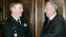 Former Canadian Prime Minister Paul Martin, right, meets with Gen. Rick Hillier in Ottawa, Jan. 14, 2005. (REUTERS/Jim Young/REUTERS/Jim Young)