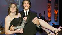 Football star Jesse Lumsden from McMaster University who won male athlete of the year, holds female athlete winner Adrienne Power star of track and field from Dalhousie University at the 13th annual BLG awards honouring Canada's best university athletes, Monday May 2, 2005, in Calgary, Alta. (CP FILE PHOTO/Jack Cusano) (Jack Cusano/CP)