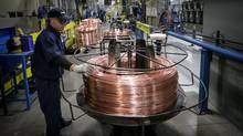 Workers produce brake and fuel lines at Caledon Tubing in St Mary's, Ont. in 2016. (Glenn Lowson/The Globe and Mail)
