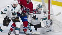 San Jose Sharks goaltender Antti Niemi, right, makes a save against Montreal Canadiens' Alex Galchenyuk as Sharks' Matt Irwin, left, defends during second period NHL action in Montreal, Saturday, October 26, 2013. (Graham Hughes/THE CANADIAN PRESS)