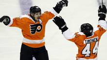 Philadelphia Flyers center Danny Briere (48) reacts with Kimmo Timonen (44), from Finland, after Briere scored the winning goal in the overtime period of Game 1 in a second-round NHL Stanley Cup hockey playoff series with the New Jersey Devils, Sunday, April 29, 2012, in Philadelphia. The Flyers won 4-3 in overtime. (AP Photo/Alex Brandon) (Alex Brandon/AP)