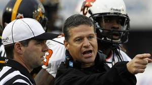 Hamilton Tiger-Cats head coach Marcel Bellefeuille (C) argues a call during the second half of their CFL Eastern semi-final football game against the B.C. Lions in Hamilton, November 15, 2009. REUTERS/Mike Cassese