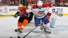 P.K. Subban #76 of the Montreal Canadiens and Danny Briere #48 of The Philadelphia Flyers battle for the puck during their game on November 22, 2010 at The Wells Fargo Center in Philadelphia, Pennsylvania. (Al Bello/2010 Getty Images)