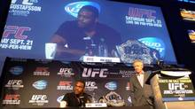 Light-heavyweight champion Jon (Bones) Jones, left, and director of UFC operations in Canada, Tom Wright, answer questions at a UFC 165 press conference in Toronto on Tuesday, July 9, 2013. (Neil Davidson/THE CANADIAN PRESS)
