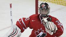 Team Canada goaltender Mark Visentin makes a save against Team United States during second period semi-final action at the World Junior Hockey Championships in Buffalo, N.Y., on Monday, January 3, 2011. (Frank Gunn)