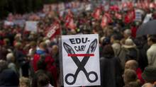 "A demonstrator holds up a sign that reads ""No to cuts in the education system"" during a protest in downtown Madrid April 29, 2012. Thousands of people protested across Spain on Sunday against government cuts. (SUSANA VERA/SUSANA VERA/REUTERS)"
