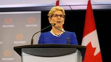 Ontario Premier Kathleen Wynne says the Liberals chose cap-and-trade over a carbon tax because the money raised will be used to help businesses reduce their greenhouse gas emissions. (MARK BLINCH/REUTERS)