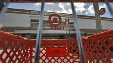 A shopping cart is parked outside the Target store in Riverview, Fla. (Chris O'Meara/The Associated Press)