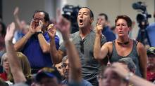 A crowd reacts during a town hall meeting at the Havert L. Fenn Center in Fort Pierce, Fla., on Friday. (Joe Raedle/Getty Images)