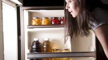 Beware the temptation to raid the fridge when you're running a home-based business. (Thinkstock)