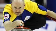Alberta skip Kevin Koe delivers a stone as they play Northwest Territories/Yukon at the Brier curling championships in Halifax, Nova Scotia, March 11, 2010. REUTERS/Shaun Best (SHAUN BEST)