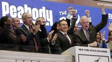 Peabody Energy Corp. President & CEO Glenn Kellow, second from right, is applauded as he rings the New York Stock Exchange opening bell, Tuesday, April 4. (Richard Drew/AP)