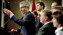 Liberal Leader Michael Ignatieff, flanked by local candidates, responds to a question during a news conference in Quebec City on April 28, 2011. (Paul Chiasson/THE CANADIAN PRESS)