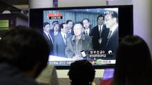 People watch file footage of North Korean leader Kim Jong Il broadcast on a TV screen in a Seoul train station on May 20, 2011. South Korean news agencies reported that Kim Jong Il travelled Friday to his country's key ally and benefactor China, raising confusion over earlier reports that it was his son Kim Jong Un who made the trip. (Lee Jin-man/Lee Jin-man/Associated Press)