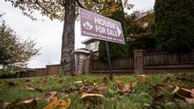 A real estate for sale sign is pictured in front of a home in Vancouver. (Ben Nelms for The Globe and Mail)